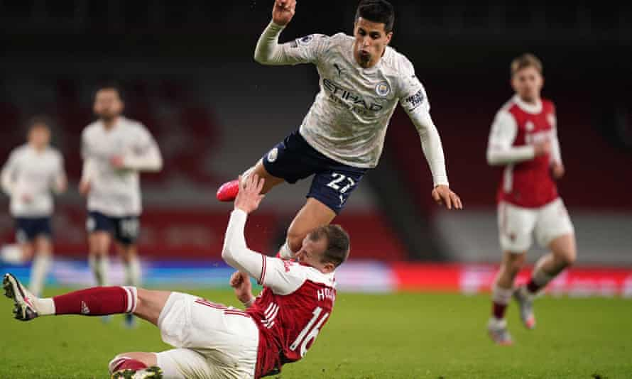 Cancelo is fouled by Rob Holding on one of his marauding runs.