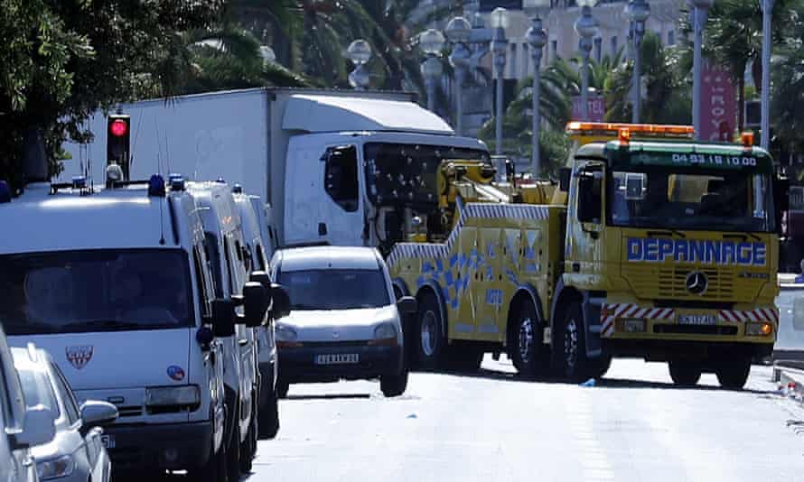 The truck used by the attacker in Nice is towed from the scene.