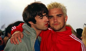 Robbie with Liam Gallagher at Glastonbury in 1995.