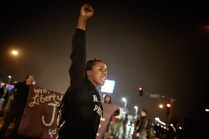 Demonstrators march through the streets while protesting the shooting death of 18-year-old Michael Brown on November 23, 2014 in St. Louis, Missouri. Tensions in Ferguson remain high as a grand jury is expected to decide this month if Ferguson police officer Darren Wilson should be charged in the shooting death of Michael Brown. November 23, 2014