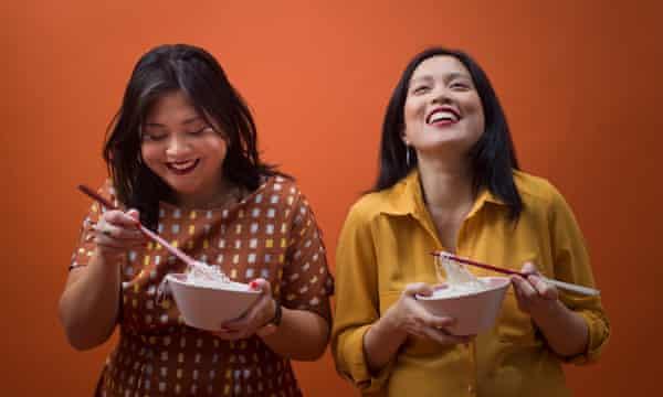 The Rangoon Sisters, Amy (far left) and Emily Chung.