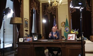 Washington governor Jay Inslee practices as he prepares to speak about additional plans to slow the spread of coronavirus before a televised address from his office Monday, March 23, 2020.