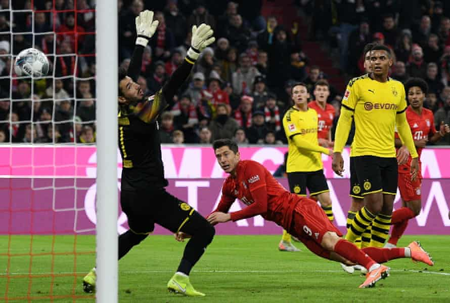 Robert Lewandowski opens the scoring with the first of his two goals in Bayern Munich's 4-0 win over Borussia Dortmund in November 2019.