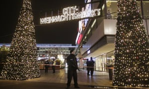 Police guard a Berlin Christmas market after a truck ran into the crowd.