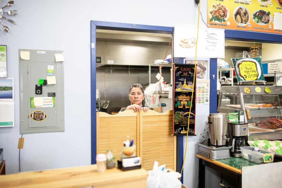 A portrait of Mai T. Her in the kitchen inside the Wausau World Market in Wausau.
