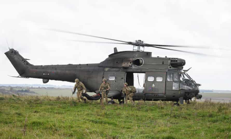 Military helicopter and soldiers