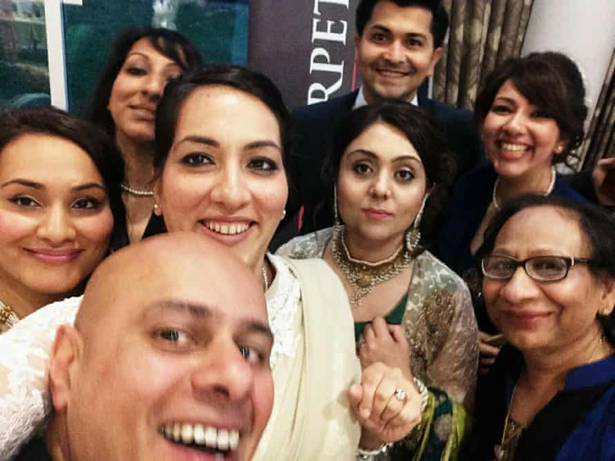 Saima Mir (wearing white) with her three sisters, mother, husband (front) and extended family in 2015.