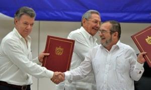 Colombian president Juan Manuel Santos, Cuban president Raúl Castro and Farc commander Timoleón Jimenez attend the signing ceremony in Havana, Cuba.