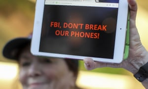 A demonstrator holds up her iPad during a rally in support of data privacy in Los Angeles, 23 Feb 2016.