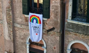 A banner hanging from a window in Venice.