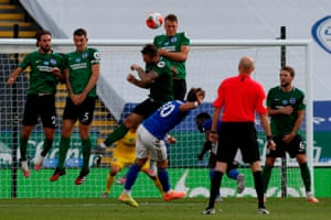 Leicester City's James Maddison (centre) hits his free-kick over the wall, and over the bar.