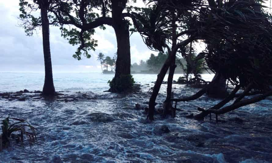 A storm surges washes across Ejit Island in Majuro Atoll, Marshall Islands.