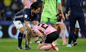 Erin Cuthbert of Scotland is consoled by Eliana Stabile of Argentina after Wednesday night's match.