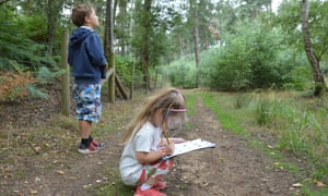 The writer's children do their wildlife-challenge checklist at RSPB The Lodge, Sandy, Bedfordshire, UK