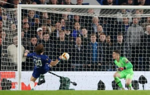 Luiz clears the shot off the line.