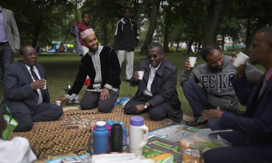 Members of the Somali community at the Birmingham Eid festival enjoy a picnic.