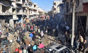 Syrians gather at the scene of a car bomb attack in Homs on 12 December.