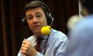 Andy Burnham in studio with headphones and microphone