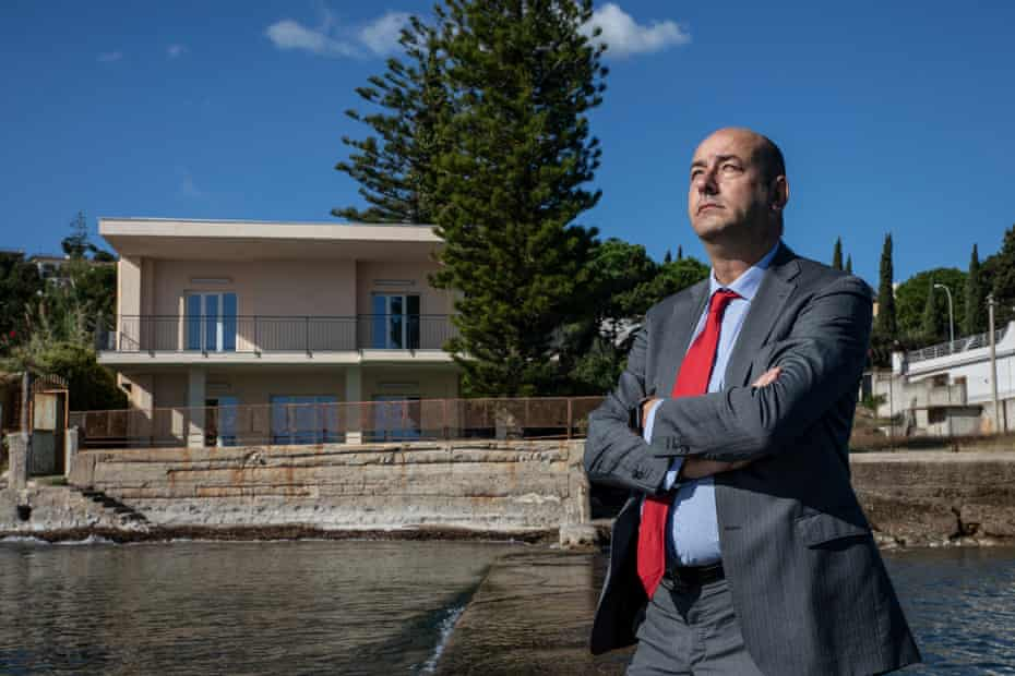 The entrepreneur Gianluca Calì, photographed in the small private harbour of his villa – previously owned by the former mafia boss of bosses, Michele Greco, and now turned into a holiday house