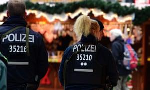 German police patrol the Christmas market near the Kaiser Wilhelm memorial church in Berlin.