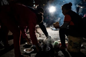 Asylum seekers from Guerrero State eat at their campsite in Ciudad Juárez, Mexico, in December 2019.