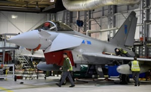 Personnel at RAF Lossiemouth maintain Typhoon aircraft.