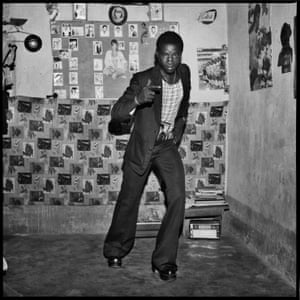 Le Malien et ses chaussures à la mode, 1975 This guy was a young Malian hipster and couldn't even wait to get in the studio as I took this picture in the dressing room of my Volta Photo studio