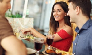 Group Of Tourists Looking On Map In Restaurant