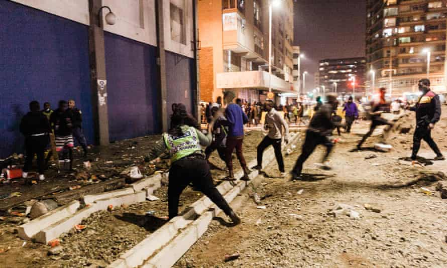 Police officers tackle looters in central Durban, South Africa.