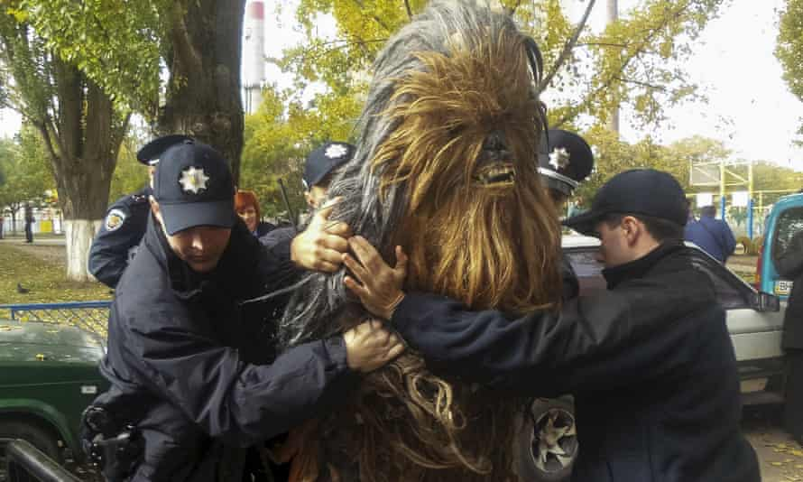 Policemen detain a person dressed as Star Wars character Chewbacca during a regional election near a polling station in Odessa, Ukraine.