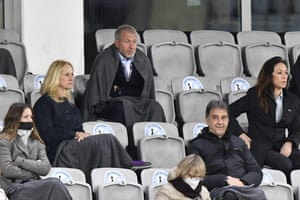Chelsea owner Roman Abramovich, top, uses a blanket to shelter from the cold as he watches the demolition job by Barcelona.