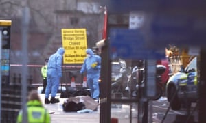 Forensics investigators work at the scene after an attack on Westminster Bridge