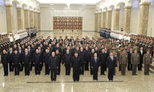 North Korean leader Kim Jong Un, centre front, stands with Politburo members and other senior officials in entrance hall of the Kumsusan Palace of the Sun in Pyongyang, North Korea, 8 July 8,