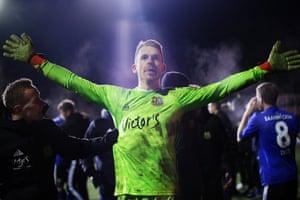 Saarbrücken goalkeeper Daniel Batz celebrates after saving a penalty to give his side victory over Fortuna Düsseldorf