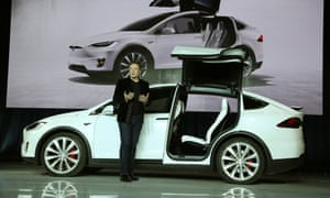 Tesla CEO Elon Musk introduces the falcon wing door on the Model X electric sports-utility vehicles during a presentation in Fremont, California, the United States, on Sept. 29, 2015.