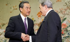 China's foreign minister Wang Yi greets New Zealand counterpart Winston Peters in Beijing in May.