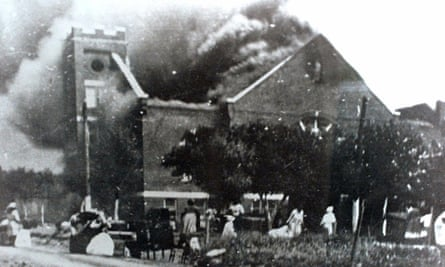 Mt Zion Baptist church burns after being torched by white mobs during the 1921 Tulsa massacre.