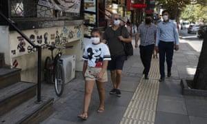 People walk along a street in Ankara, Turkey.