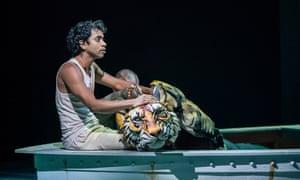 Superb … Hiran Abeysekera as Pi with Richard Parker the Royal Bengal tiger.