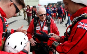 D-Day veteran Harry Read makes his final preparations with members of the Army Parachute Display Team before flying to Normandy in France where he will make a parachute jump as part of the 75th D-Day commemorations, in Duxford, Britain, June 5, 2019.