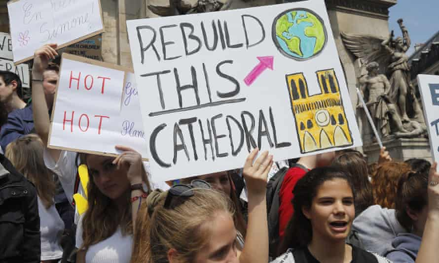 Young people take part in a climate march in Paris in May