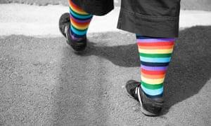 A woman wears rainbow socks in celebration of gay Pride.