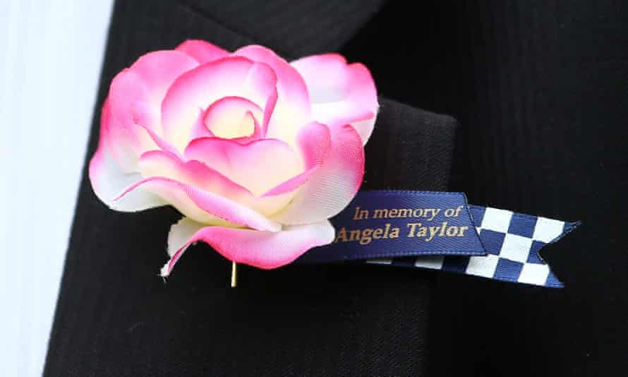 A flower pin worn by a police officer in memory of Constable Angela Taylor on the 30th anniversary of the Russell Street bombing, which killed Taylor and injured 21 others