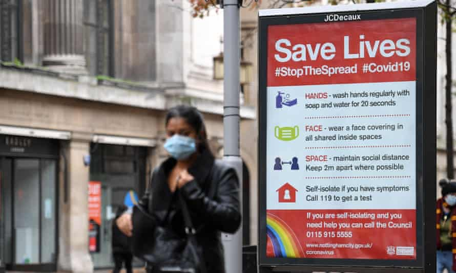 A street ad on how to help restrict the spread of coronavirus in central Nottingham, a city witnessing a recent spike in new cases.