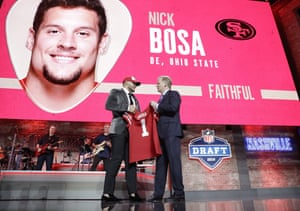 Nick Bosa poses with NFL commissioner Roger Goodell after being selected No2 overall