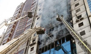 Firefighters work to extinguish the fire at the Dhaka office block.