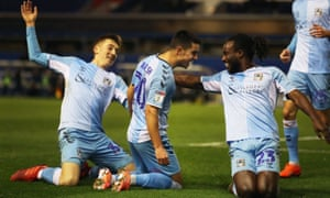 Liam Walsh and Coventry celebrate their late win over Rochdale.