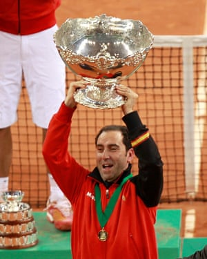 Captain Albert Costa lifts the Davis Cup trophy as captain in 2011.