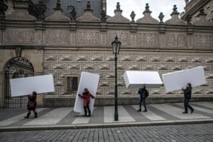 People carry large paper boxes to create a symbolic wall as they protest in front of Prague castle,  Czech Republic