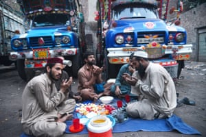 Lorry drivers offer prayers before breaking their fast